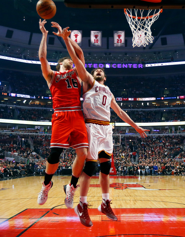 . Cleveland Cavaliers forward Kevin Love (0) knocks the ball from the hands of Chicago Bulls center Pau Gasol (16) during the first half of an NBA basketball game in Chicago on Saturday, April 9, 2016. (AP Photo/Jeff Haynes)