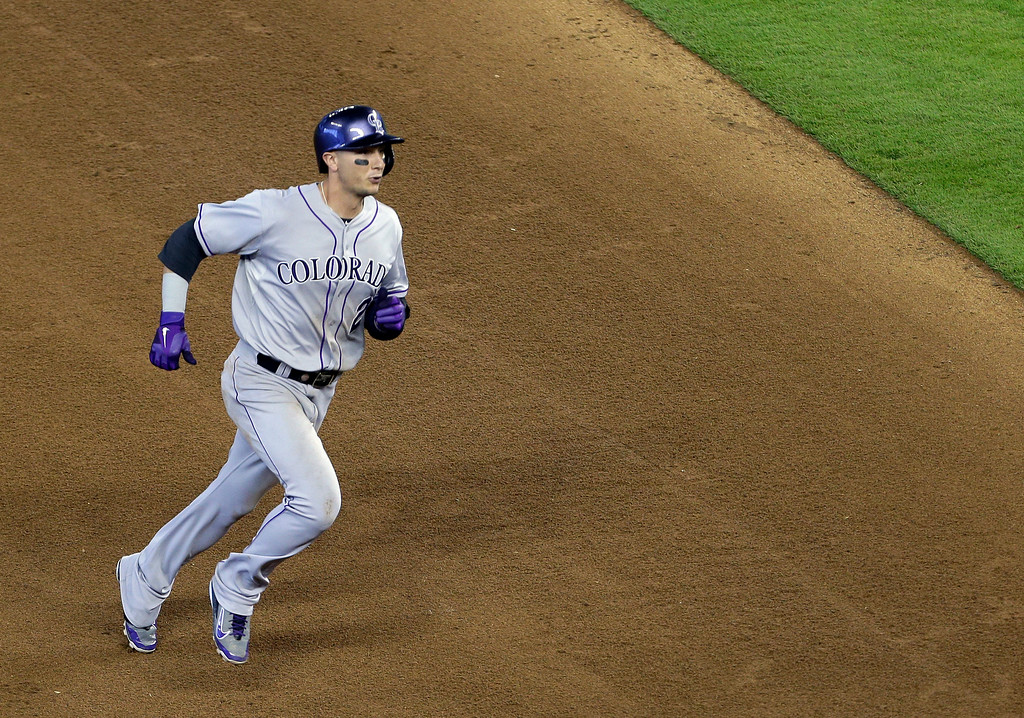 . Colorado Rockies\' Troy Tulowitzki runs to third base with a triple in the fifth inning of a baseball game against the Miami Marlins, Thursday, April 3, 2014, in Miami. (AP Photo/Lynne Sladky)