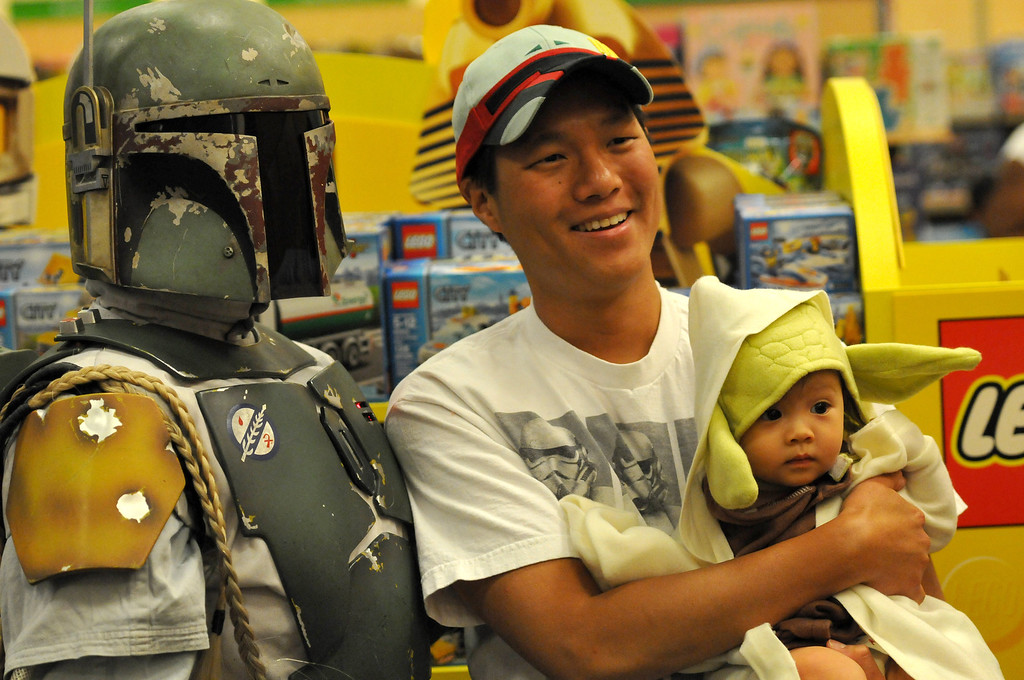 . (John Valenzuela/Staff Photographer) David Chang of Redlands and daughter Samantha, poses for a photo with Boba Fett at Barnes & Noble Bookstore in Redlands during the Star Wars Reads Day, Saturday, Oct. 5, 2013.