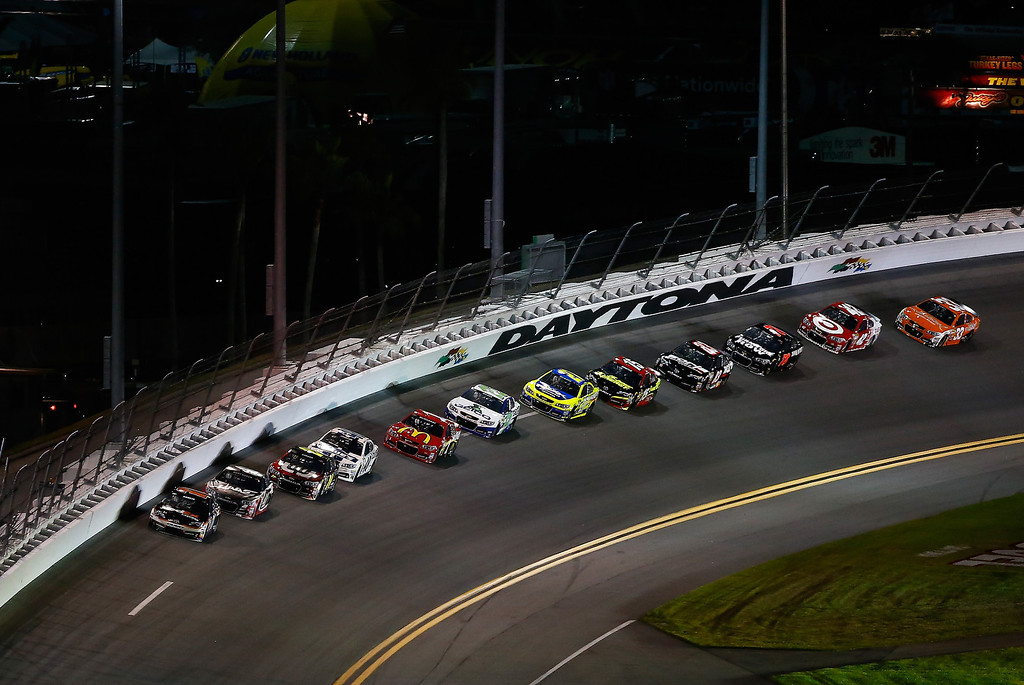 . Denny Hamlin, driver of the #11 FedEx Express Toyota, leads a pack of cars during the NASCAR Sprint Cup Series Budweiser Duel 2 at Daytona International Speedway on February 20, 2014 in Daytona Beach, Florida.  (Photo by Brian Lawdermilk/Getty Images)