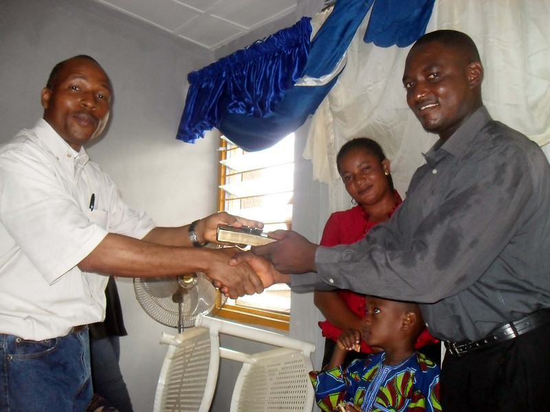 10 09-10  FC Nigeria director Sam Odia gives Bible and house keys to HO Bright Kaalu family. so