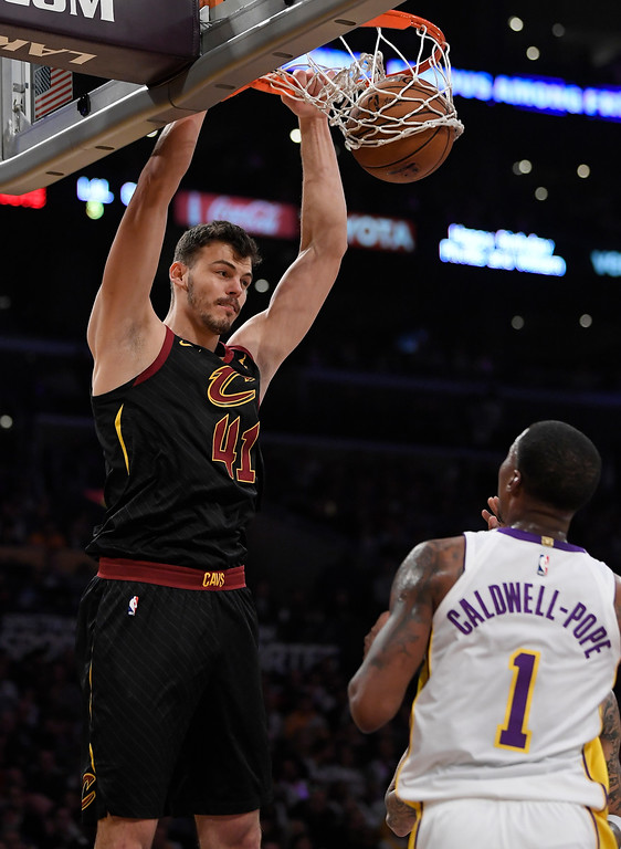 . Cleveland Cavaliers forward Ante Zizic, left, of Croatia, dunks as Los Angeles Lakers guard Kentavious Caldwell-Pope watches during the first half of an NBA basketball game, Sunday, March 11, 2018, in Los Angeles. (AP Photo/Mark J. Terrill)