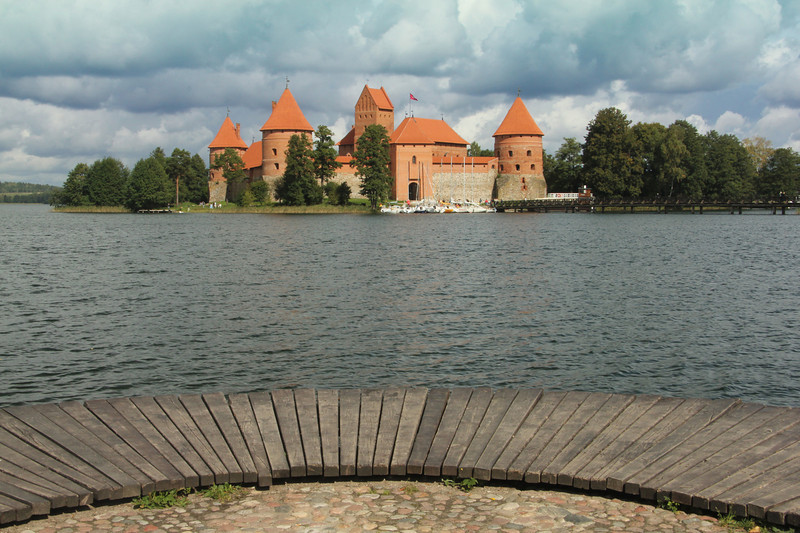 Situated about 17 miles west of Vilnius on Lake Galvė, is the picturesque Trakai Castle. Construction of this Gothic masterpiece originally began in the 14th century, however, it was seriously damaged during the war with Muscovy in 1655 and was eventually abandoned. In the 19th century attempts were made to rebuild it, but ironically it was during the Soviet occupation of Lithuania that the Castle was eventually restored to its former glory, with work beginning soon after the end of WWII.