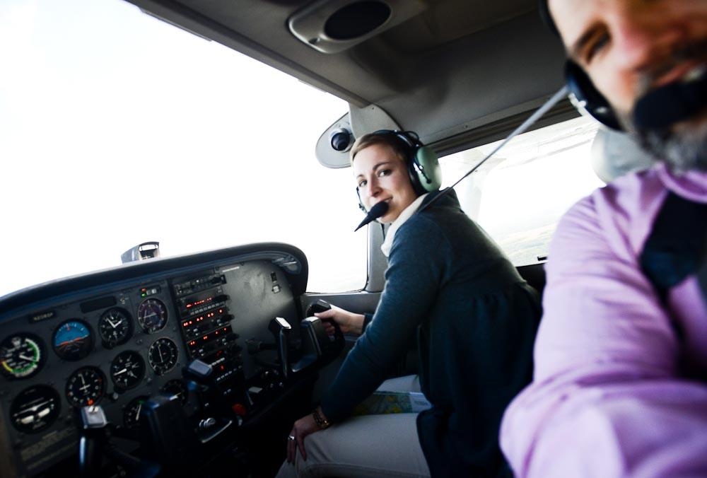 . Photographer Ben Garvin, right, and pilot Haley Barrett airborne over Stillwater Tuesday, Oct.8, 2013. (Pioneer Press: Ben Garvin)
