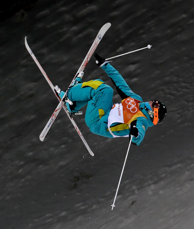 . Dmitriy Reikherd, of Kazakhstan, jumps during the men\'s moguls qualifying at Phoenix Snow Park at the 2018 Winter Olympics in Pyeongchang, South Korea, Monday, Feb. 12, 2018. (AP Photo/Lee Jin-man)