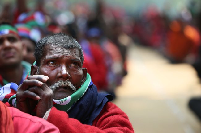. An Indian railway porter along with others participates in a protest rally in New Delhi, India , Wednesday, Feb. 20, 2013. The porters demanded regularization of jobs in the railways along with medical benefits. (AP Photo/Manish Swarup)