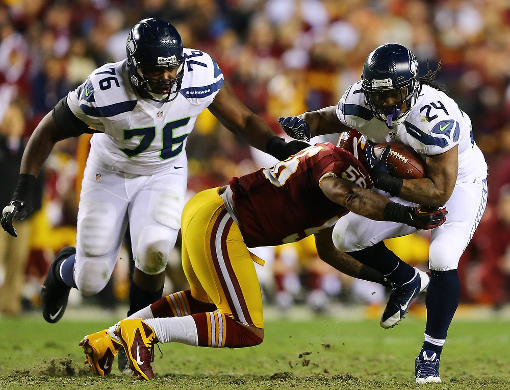 . Marshawn Lynch #24 of the Seattle Seahawks is tackled by  Perry Riley #56 of the Washington Redskins in the second quarter of the NFC Wild Card Playoff Game at FedExField on January 6, 2013 in Landover, Maryland.  (Photo by Al Bello/Getty Images)