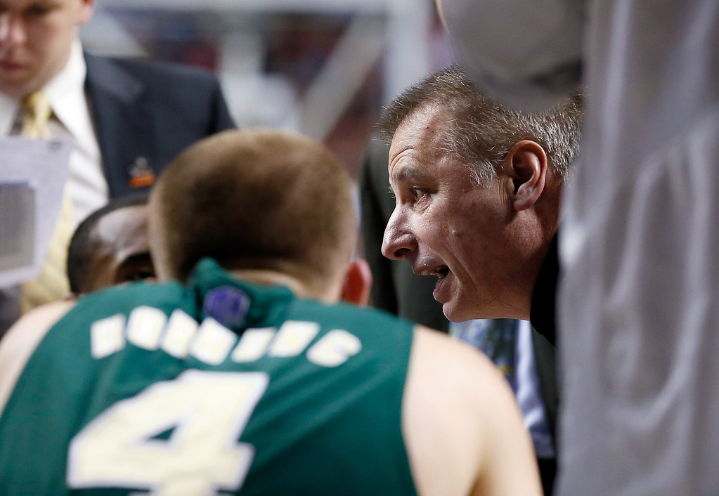 . LEXINGTON, KY - MARCH 23: Head coach Larry Eustachy of the Colorado State Rams talks to his players during a timeout in the first half against the Louisville Cardinals during the third round of the 2013 NCAA Men\'s Basketball Tournament at Rupp Arena on March 23, 2013 in Lexington, Kentucky.  (Photo by Kevin C. Cox/Getty Images)