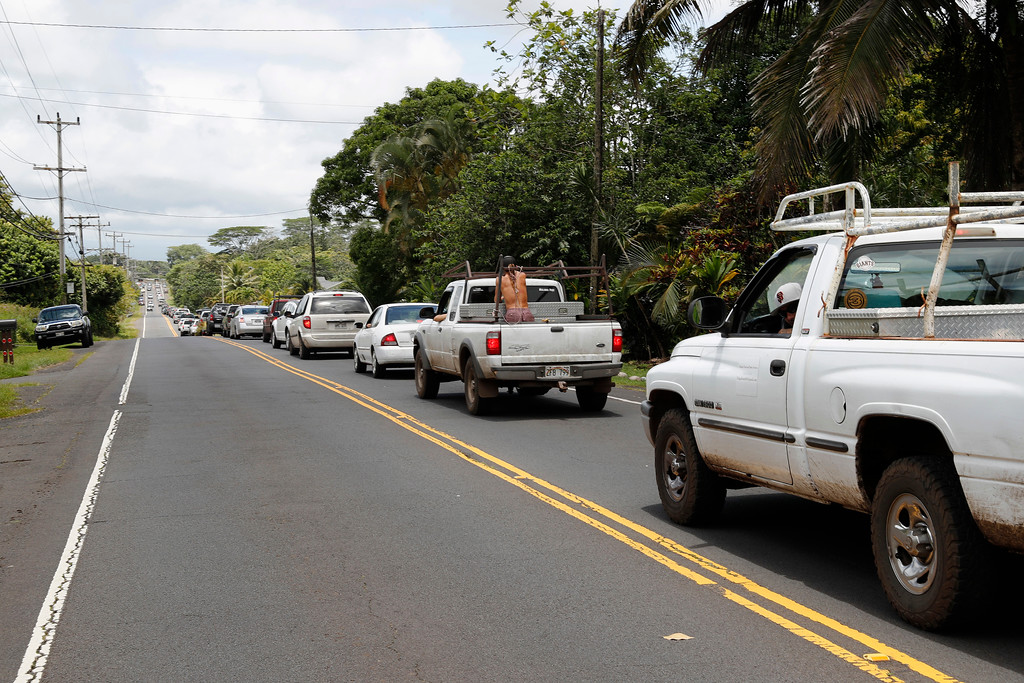 . A line of traffic is seen going towards Pahoa town, Sunday, May 6, 2018, near Pahoa, Hawaii. Scientists reported lava spewing more than 200 feet (61 meters) into the air in Hawaii\'s recent Kilauea volcanic eruption, and some of the more than 1,700 people who evacuated prepared for the possibility they may not return for quite some time. (AP Photo/Marco Garcia)
