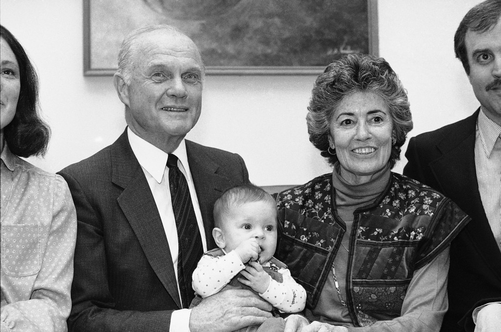 . Sen. John Glenn (D-Ohio), left, poses in his Capitol Hill office with his wife Annie Glenn, right, and 7-month-old grandson Daniel, April 20, 1983, in Washington, D.C. Glenn\'s announcement of the presidential candidacy is slated for Thursday in New Concord, Ohio, his hometown. (AP Photo/Ira Schwarz)