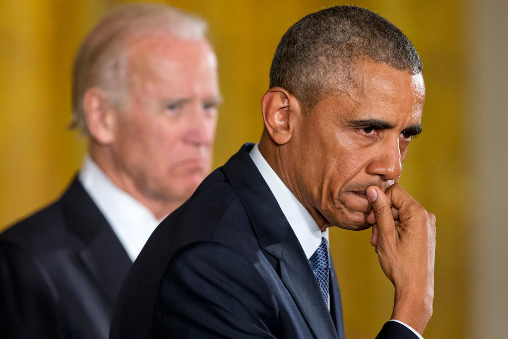 . An emotional President Barack Obama, joined by Vice President Joe Biden, pauses as he recalled the 20 first-graders killed in 2012 at Sandy Hook Elementary School, while speaking in the East Room of the White House in Washington, Tuesday, Jan. 5, 2016, about steps his administration is taking to reduce gun violence. (AP Photo/Jacquelyn Martin)