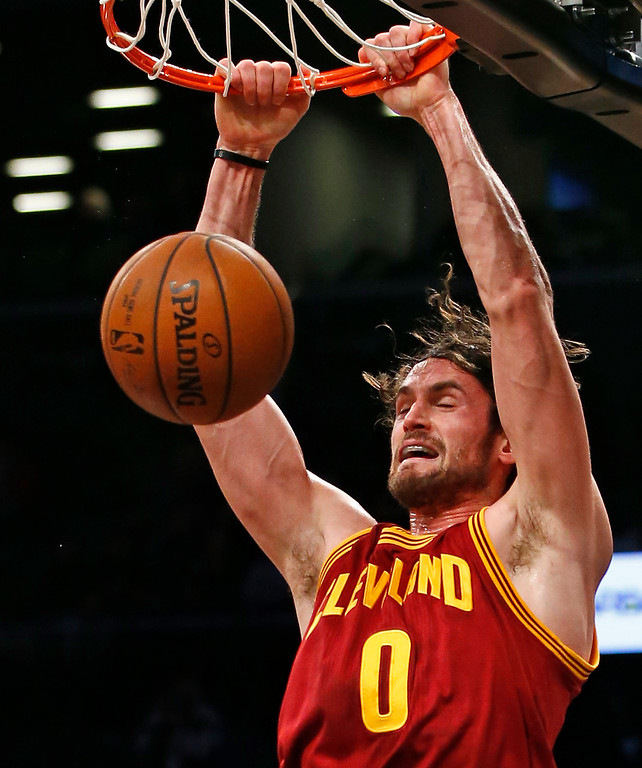 . Cleveland Cavaliers forward Kevin Love (0) dunks in the first half of an NBA basketball game against the Brooklyn Nets, Wednesday, Jan. 20, 2016, in New York. Love had 17 points along with LeBron James to help the Cavaliers defeat the Nets 91-78. (AP Photo/Kathy Willens)