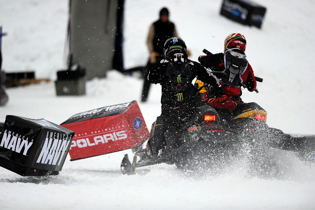 . ASPEN, CO - January 26: Joe Parsons, left, and Willie Elam, right, tangle for the second time during the start of the Snowmobile Speed & Style bronze medal match at Winter X Games Aspen 2013 at Buttermilk Mountain on Jan. 26, 2013, in Aspen, Colorado. Parsons eventually took bronze after the next start was clean. (Photo by Daniel Petty/The Denver Post)