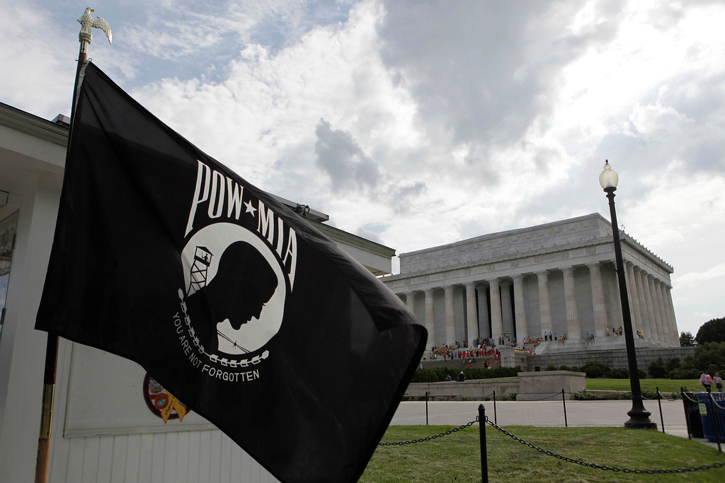 . The POW/MIA flag waves near the Lincoln Memorial before Memorial Day in Washington May 23, 2013. The flag was designed during the Vietnam War as a symbol of national concern about U.S. military personnel taken as prisoners of war (POWs) or listed as missing in action (MIA). REUTERS/Yuri Gripas