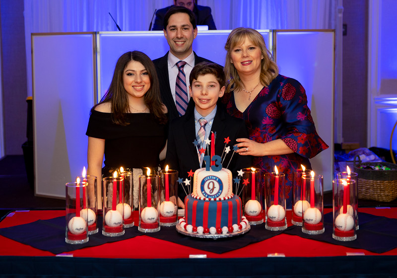 Family around the lit cake.jpg