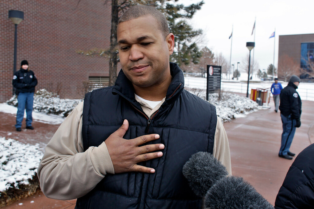. Aurora theater shooting victim Marcus Weaver speaks with members of the media following the arraignment of Aurora shooting suspect James Holmes, at district court in Centennial, Colo., on Tuesday, March 12, 2013. (AP Photo/Brennan Linsley)