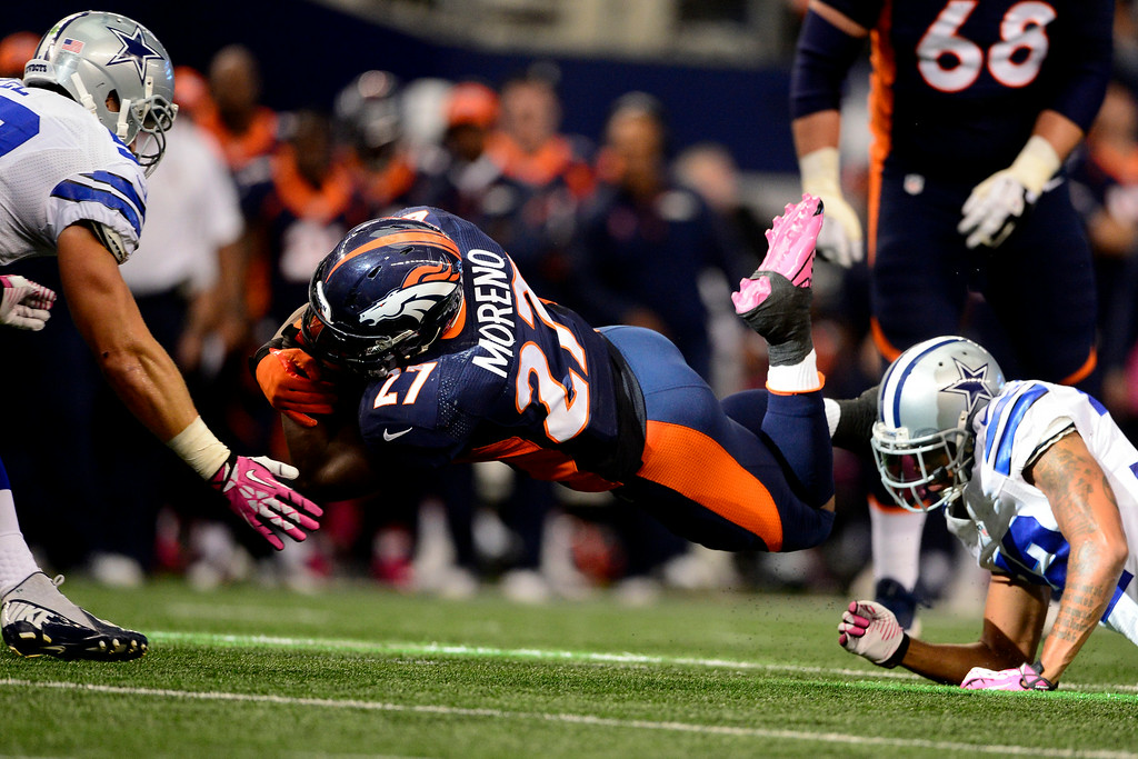 . Former Bronco Knowshon Moreno dives for yards against the Cowboys. (AAron Ontiveroz/The Denver Post)