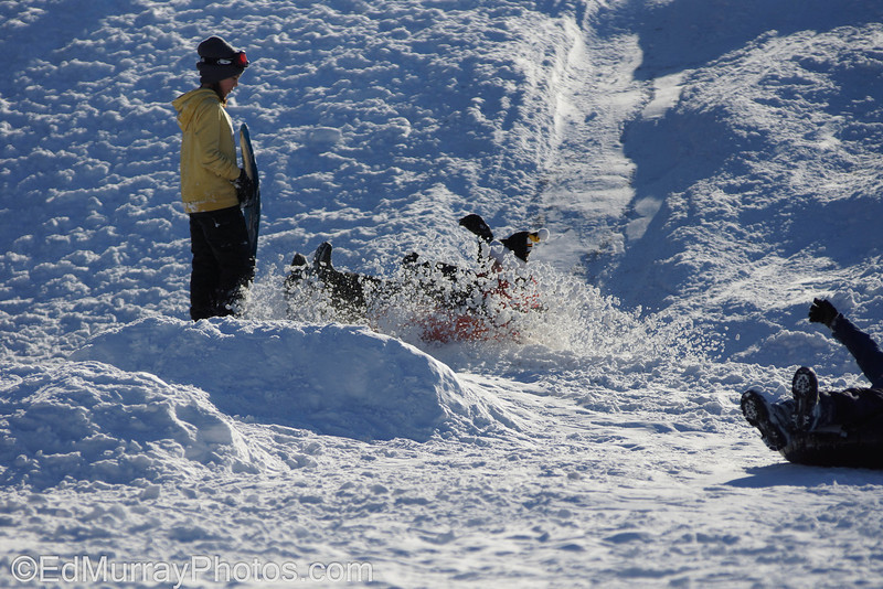 A couple of kids wipe out sledding at the Veterans School