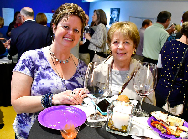 5/3/2019 Mike Orazzi | Staff Tracy Vontell and Claudette Lloyd during the From the Vine wine tasting event at the Imagine Nation Museum Early Learning Center Friday evening.