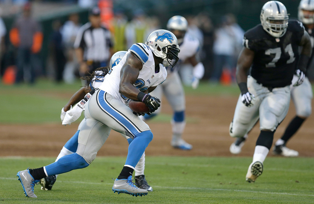 . Detroit Lions strong safety James Ihedigbo returns an intercepted pass thrown by Oakland Raiders quarterback Matt Schaub during the first quarter of an NFL preseason football game in Oakland, Calif., Friday, Aug. 15, 2014. (AP Photo/Ben Margot)