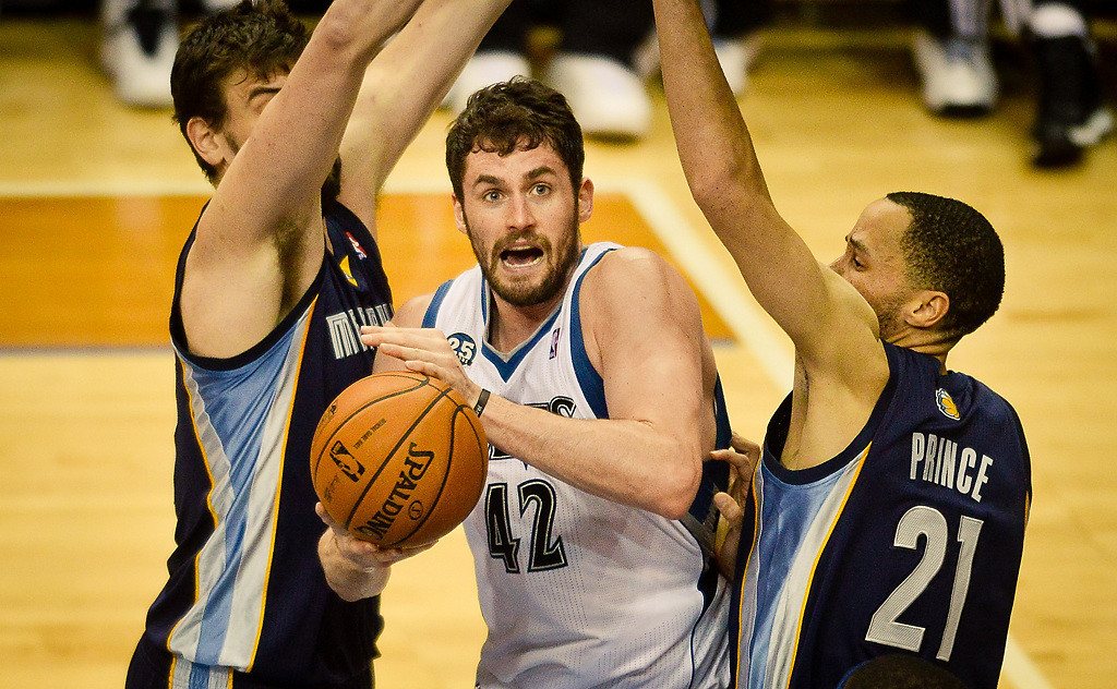 . Minnesota Timberwolves power forward Kevin Love tries to score under heavy defense from Memphis Grizzlies small forward Tayshaun Prince, right, and center Marc Gasol in the second quarter. (Pioneer Press: Ben Garvin)