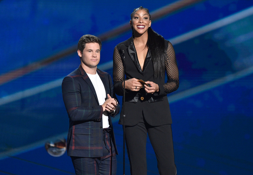 . Adam Devine, left, and WNBA player Candace Parker, of the Los Angeles Sparks, present the coach of the year award at the NBA Awards on Monday, June 25, 2018, at the Barker Hangar in Santa Monica, Calif. (Photo by Chris Pizzello/Invision/AP)