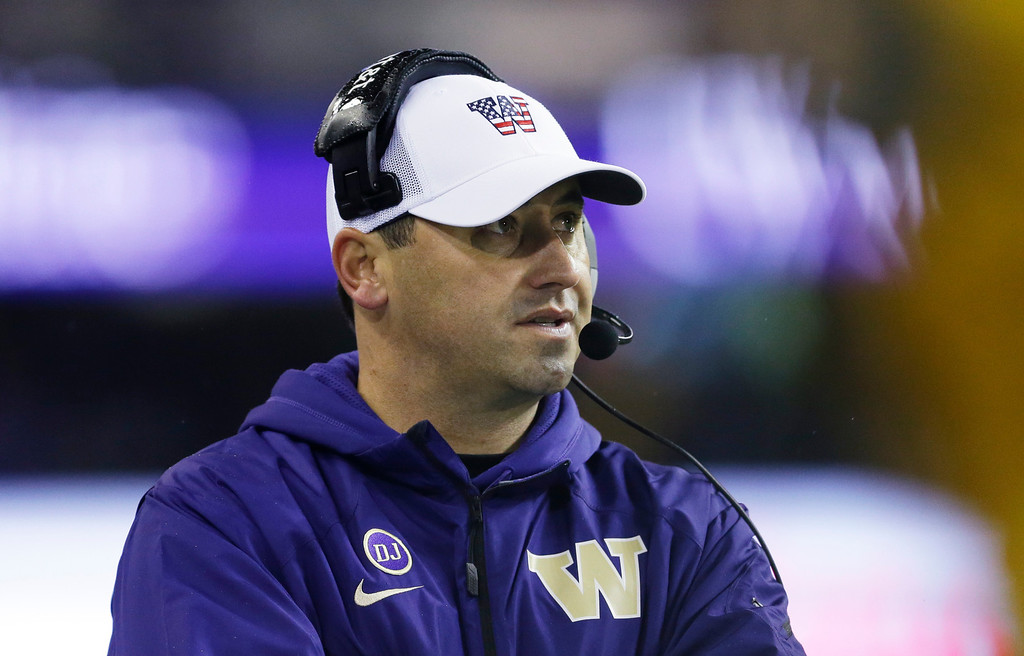 . Washington head coach Steve Sarkisian talks on his headset during the second half of an NCAA college football game against Colorado, Saturday, Nov. 9, 2013, in Seattle. (AP Photo/Ted S. Warren)