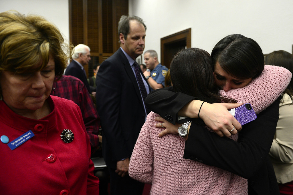. DENVER, CO - MARCH 4: A supporter hugs Kim Weeks after a vote passed that would ban concealed to carry guns on college campuses at the State Capitol. Both Weeks was a victim of rape on her college campus where concealed guns were also banned. Four gun bills were up for debate. (Photo by AAron Ontiveroz/The Denver Post)