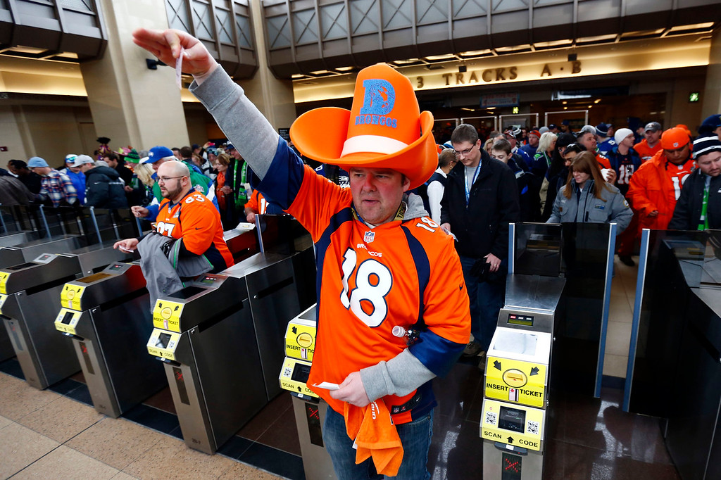 . Football fans enter the Secaucus Junction, Sunday, Feb. 2, 2014, in Secaucus, N.J. The Seattle Seahawks are scheduled to play the Denver Broncos in the NFL Super Bowl XLVIII football game on Sunday evening at MetLife Stadium in East Rutherford, N.J. (AP Photo/Matt Rourke)