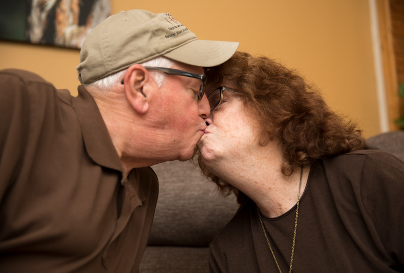 Mam and Badge Kissing on the Couch 2.jpg