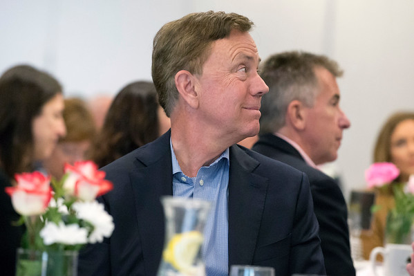 05/13/19 Wesley Bunnell | Staff Governor Ned Lamont spoke with the Central Connecticut Chambers of Commerce on Monday in Bristol. Governor Lamont looks at the podium as he is introduced to the chamber.