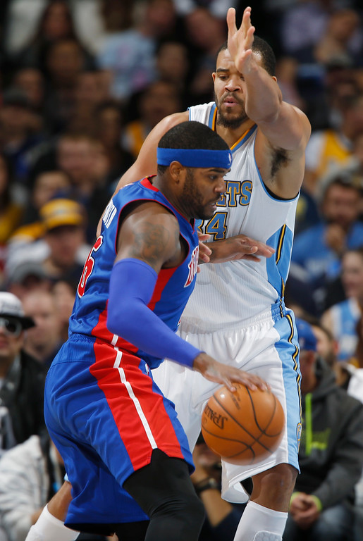 . Detroit Pistons forward Josh Smith, front, works the ball inside as Denver Nuggets center JaVale McGee covers in the fourth quarter of the Nuggets\' 89-79 victory in an NBA basketball game in Denver on Wednesday, Oct. 29, 2014. (AP Photo/David Zalubowski)