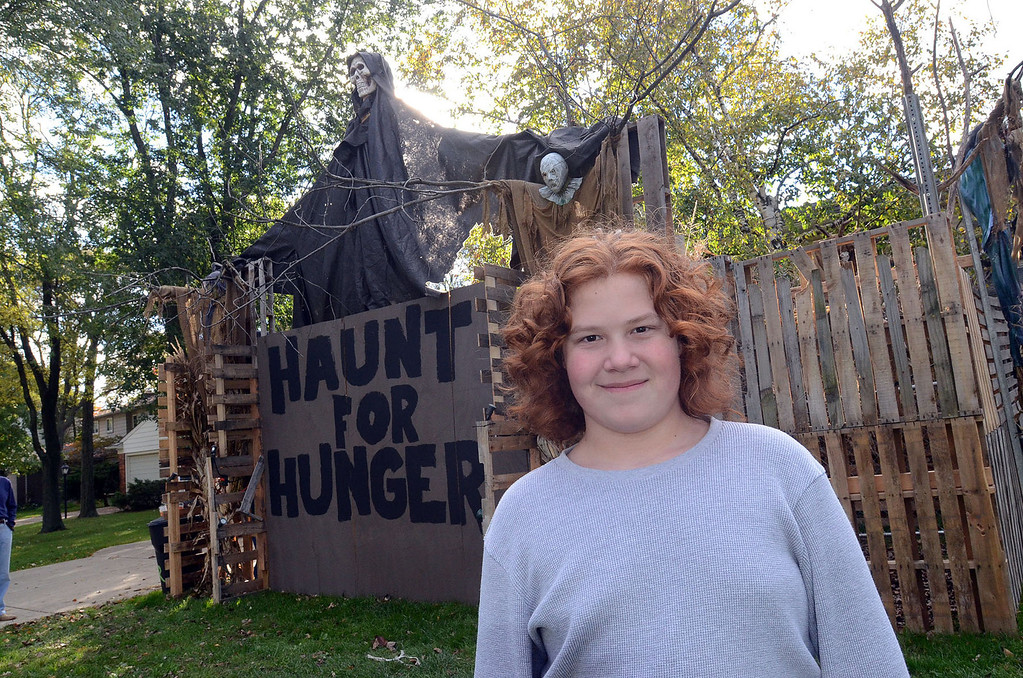 """. Cameron Morency, 12, of Southfield, in front of his \""""haunted yard\"""" he came up with as a way of asking for food donations for those who are hungry, pictured Wednesday October 23, 2013. (Oakland Press Photo:Vaughn Gurganian)"""