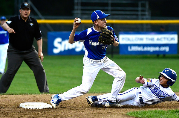 8/9/2018 Mike Orazzi | Staff Keystone Little League's Braylen Corter (22) starts a double play on Maryland's Gavin Solito (2) at Breen Field in Bristol during Thursday evenings 2018 Eastern Regional Little League Baseball Tournament.