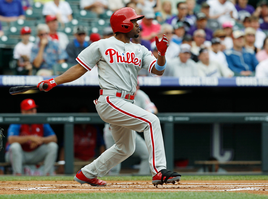 . Philadelphia Phillies\' Jimmy Rollins flies out against the Colorado Rockies in the first inning of a baseball game in Denver on Sunday, June 16, 2013. (AP Photo/David Zalubowski)