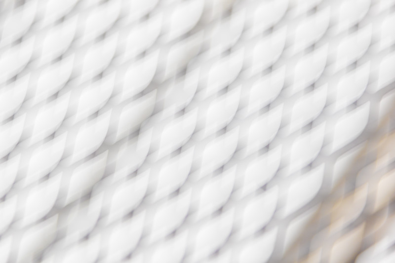 A chainlink fence like pattern is blurred out of focus in an abstract photo
