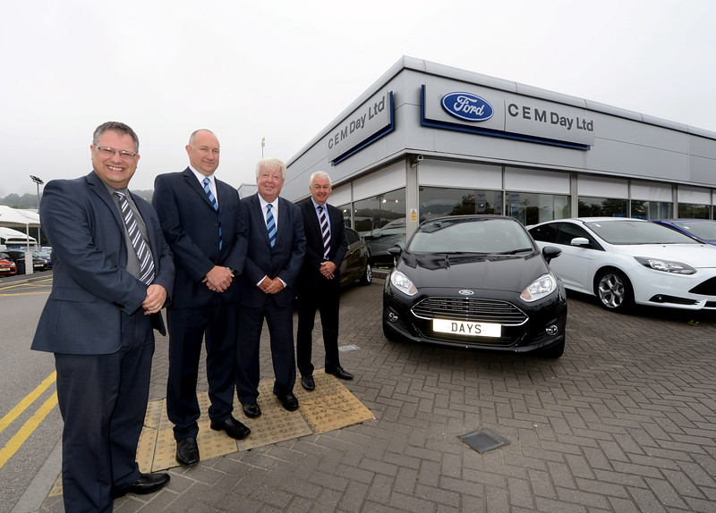 Corporate portrait shot of Ian Clarke representing PwC, Russ Day, Day's Motor Group director, Graham Day, chairman and chief executive of Day's Motor Group and Michael Hayden, Barclays director Mid and South West Wales.