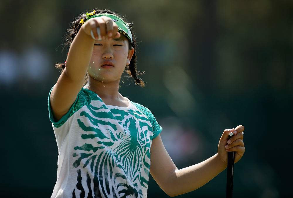 . Eleven-year old Amateur Lucy Li of the United States waits on a tee box during a practice round prior to the start of the 69th U.S. Women\'s Open at Pinehurst Resort & Country Club, Course No. 2 on June 17, 2014 in Pinehurst, North Carolina.  (Photo by Scott Halleran/Getty Images)