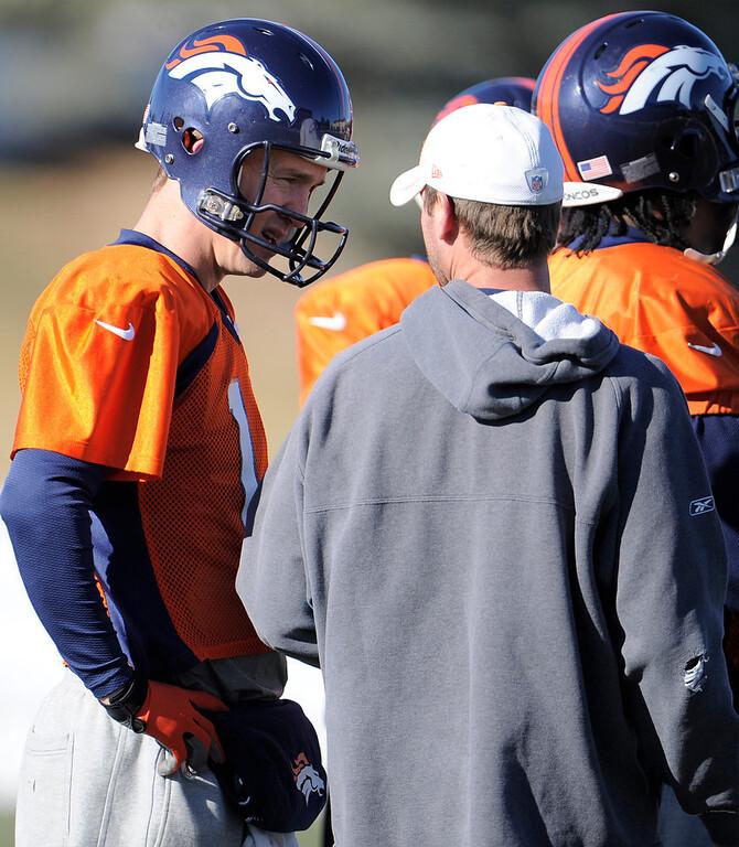 . Denver Broncos quarterback Peyton Manning (18) talks with quarterbacks coach Adam Gase during practice Thursday, December 20, 2012 at Dove Valley.  John Leyba, The Denver Post