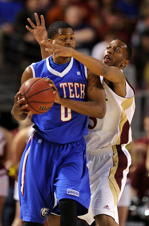 . Denver defender Jalen Love (3) got in the face of Bulldogs guard Alex Hamilton (0) in the first half. The University of Denver men\'s basketball team hosted the Louisiana Tech Bulldogs at Magness Arena Saturday night, March 9, 2013. (Photo By Karl Gehring/The Denver Post)