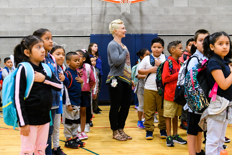 Second-grade teacher Carrie Clancy helps lead her students in reciting the Pledge of Allegiance. Back to school day at Hallman Elementary School on Wednesday, September 4, 2019 in Salem, Ore.