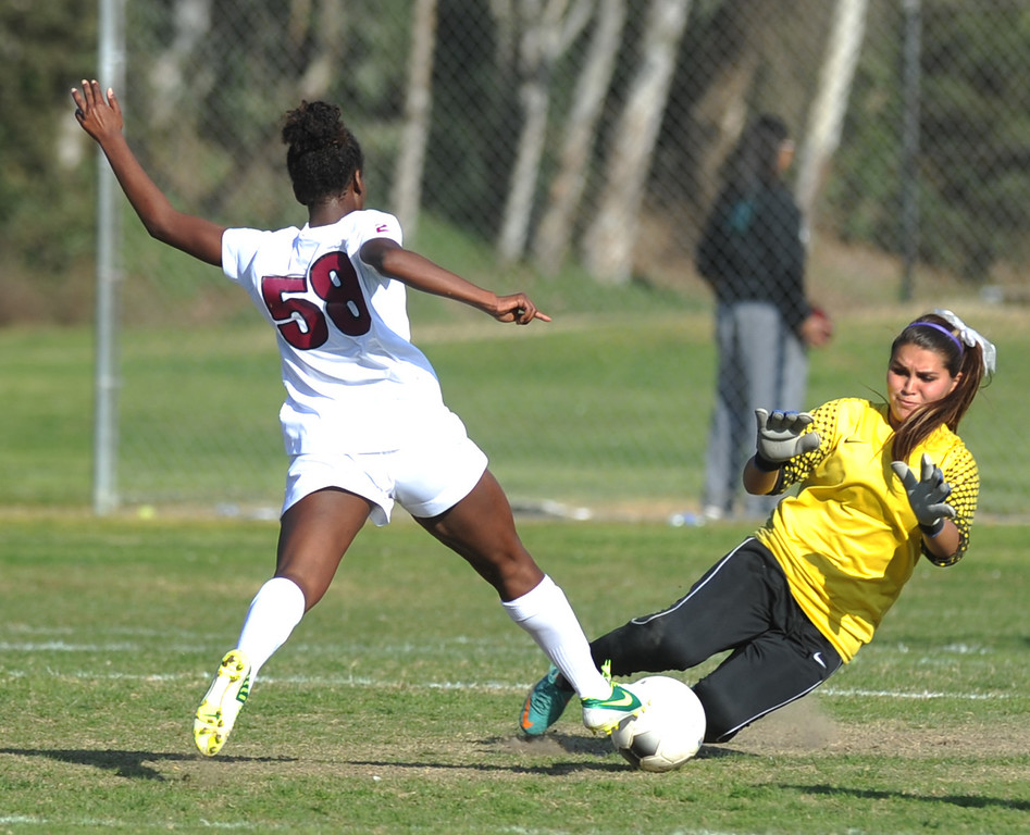. La Serna\'s Moriah Earley (#58) tries for a goal but it is blocked by Temescal Canyon goal keeper Maegan Ariaz in their CIF-SS girls soccer Division 5 quarterfinal game at La Serna High School in Whittier on Thursday February 21, 2013. La Serna beat Temescal Canyon 2-0. (SGVN/Staff Photo by Keith Durflinger)