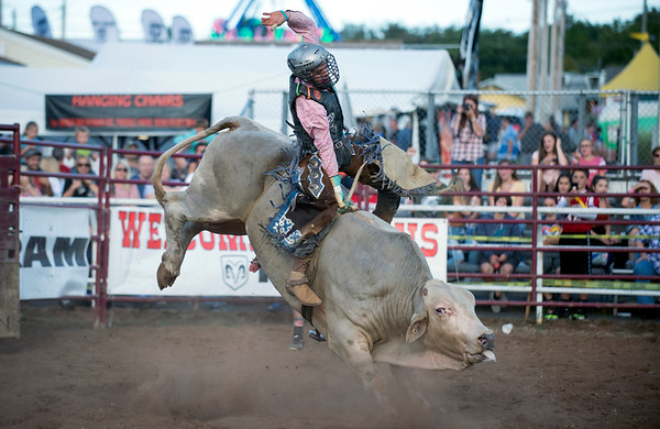 09/13/19 Wesley Bunnell | StaffrrCody West, of Markleville Indiana, competing in the the bull riding competition at the Berlin Fair on Friday evening.
