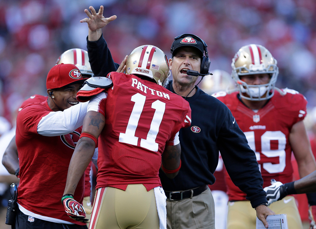 . 49ers wide receiver Quinton Patton (11) is congratulated by head coach Jim Harbaugh after scoring on a five-yard touchdown reception during the first quarter against the Vikings. (AP Photo/Marcio Jose Sanchez)