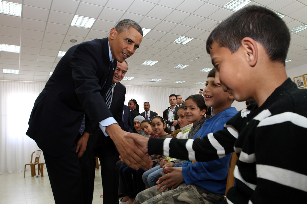. U.S. President Barack Obama shakes hands with Palestinian children during his visit to Al Bera Youth Center March 21, 2013 in Ramallah, the West Bank. (Photo by Alaa Badarneh-Pool/Getty Images)