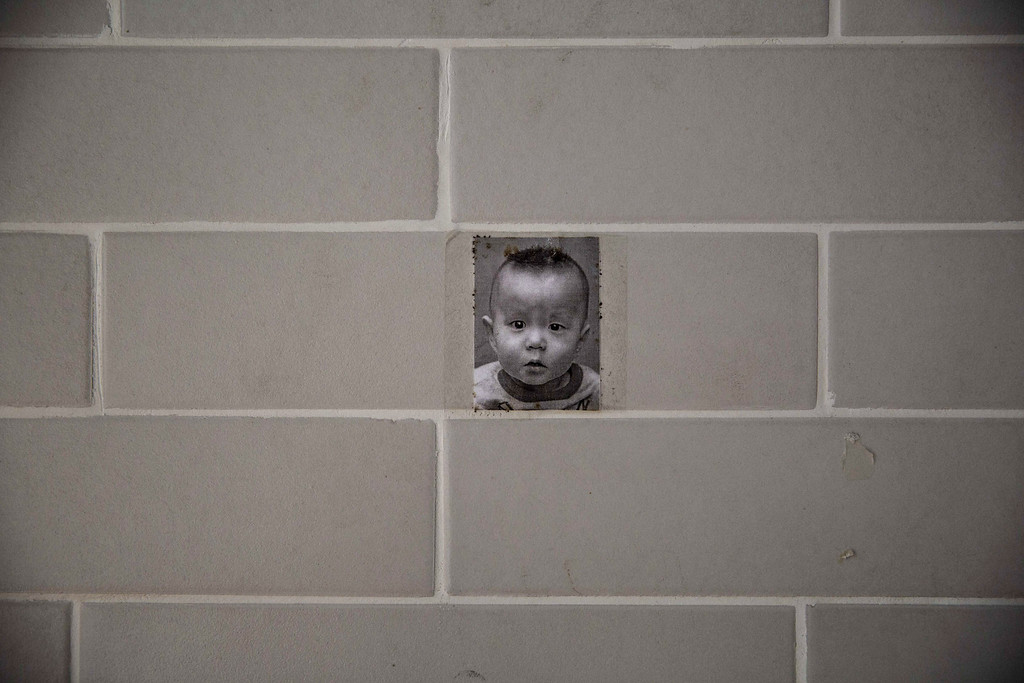 . A photo of a young  Chinese orphaned boy hangs on the wall at a foster care center on April 2, 2014 in Beijing, China.  (Photo by Kevin Frayer/Getty Images)