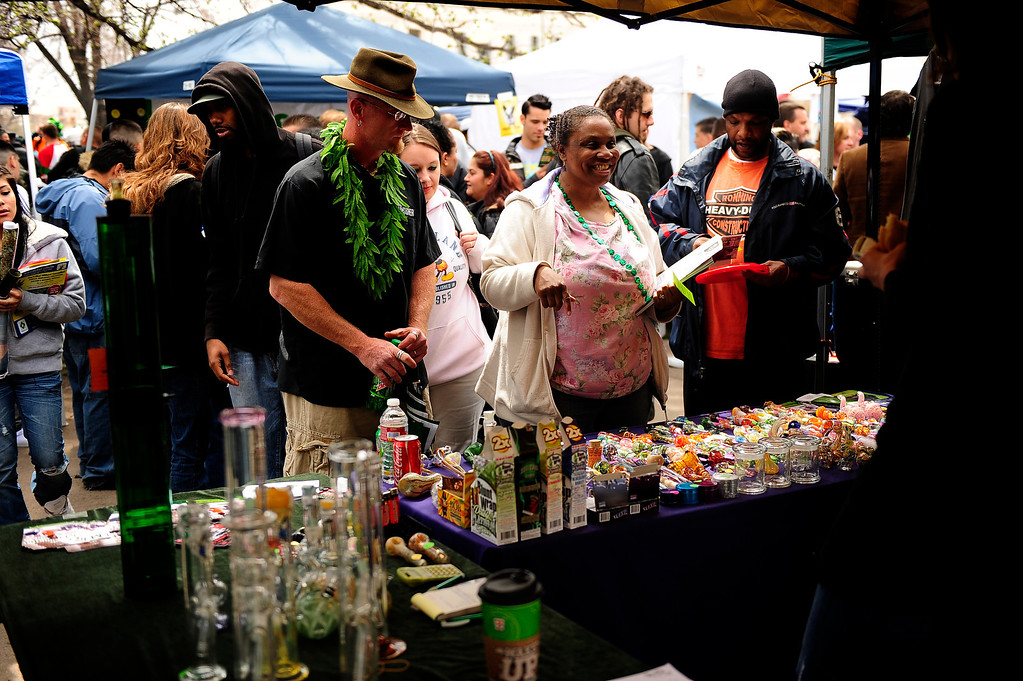 . Festival goers looking over the wares on the midway at the Annual Denver 420 Rally in Civic Center Park.      Joe Amon, The Denver Post