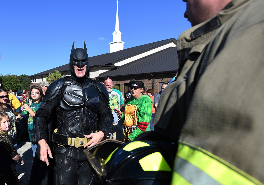 . A man dressed as Batman arrives during a superhero-themed funeral service for Jacob Hall at Oakdale Baptist Church on Wednesday, Oct. 5, 2016, in Townville, S.C. Hall\'s family has encouraged people to dress as superheroes to celebrate what he enjoyed. (AP Photo/Rainier Ehrhardt)