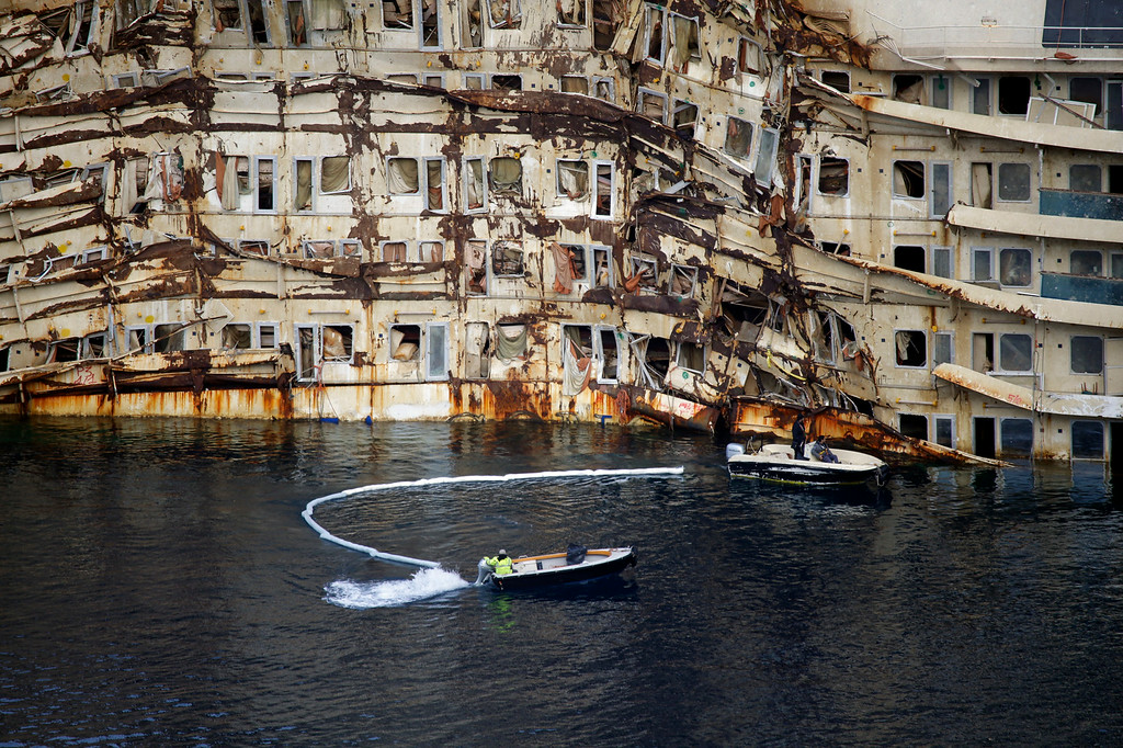 . A partial view of the Costa Concordia cruise ship, on the Tuscan Island of Giglio, Italy, Monday, Jan. 13, 2014. Survivors of the capsized Costa Concordia are commemorating the second anniversary of the grounding off Tuscany that killed 32 people with a candlelight march on Giglio island and a moment of silence in the Italian courtroom where the captain is on trial. (AP Photo/Gregorio Borgia)