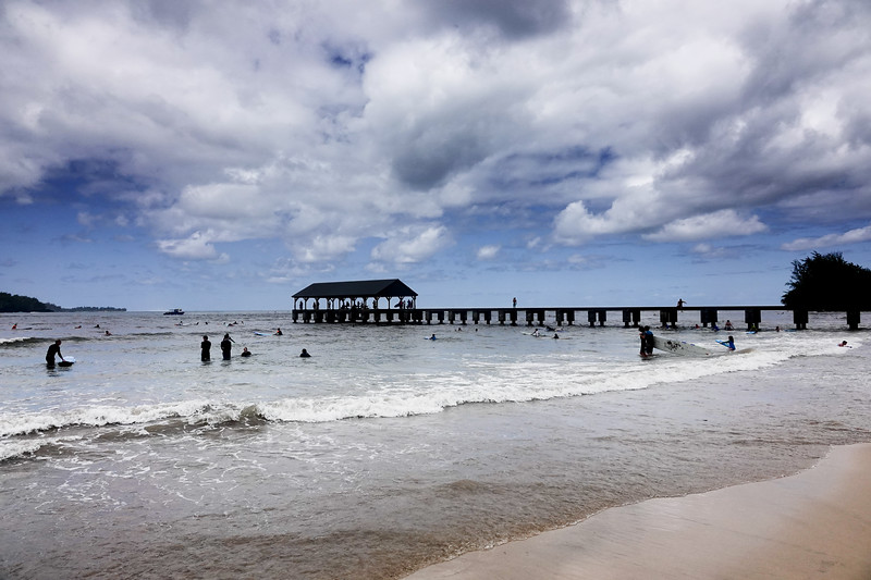 The historic Hanalei Pier is a major spot for fishing enthusiasts and parents to watch their kids surfing